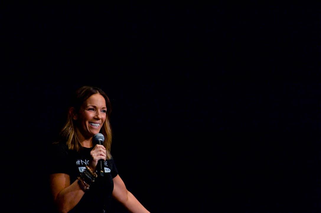 Martha Krejci smiling with mic