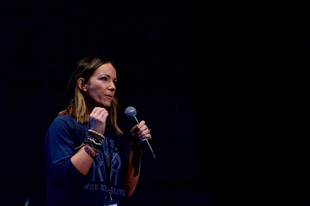 Martha Krejci talking into microphone