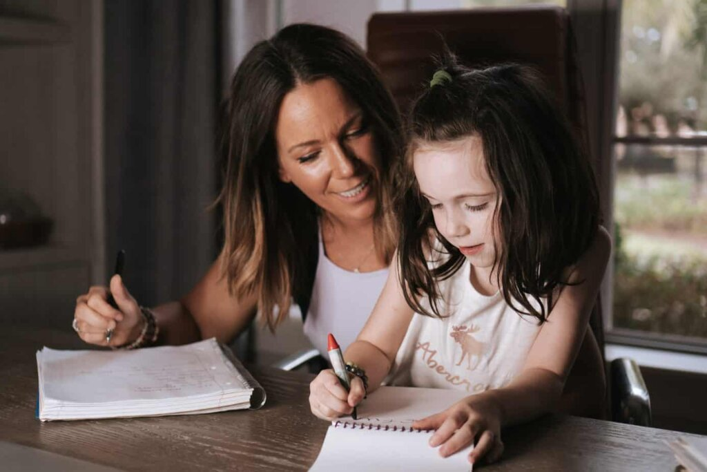 Martha with daughter drawing
