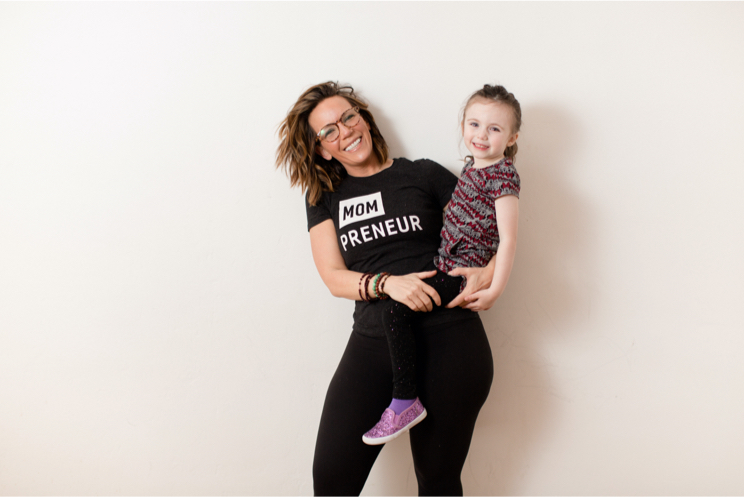 Martha and her daughter posing in front of a white background